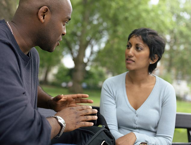 man having discussion with woman